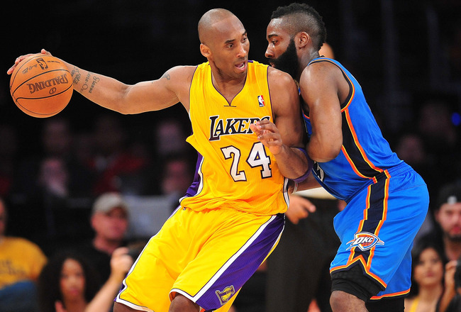 May 18, 2012; Los Angeles, CA, USA; Los Angeles Lakers shooting guard Kobe Bryant (24) moves the ball against the defense of Oklahoma City Thunder guard James Harden (13) during the first half of game three of the Western Conference semifinals of the 2012