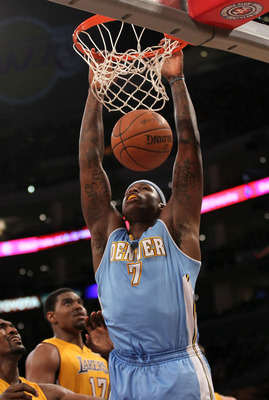 Al Harrington dunks in the Nuggets' playoff series against the Lakers.