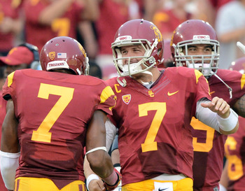 LOS ANGELES, CA - SEPTEMBER 22:  Matt Barkley #7 of the USC Trojans celebrates a defensive stop late in the game with T.J. McDonald #7 during the game against the California Golden Bears at Los Angeles Memorial Coliseum on September 22, 2012 in Los Angele
