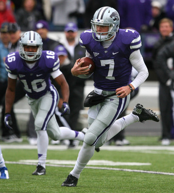 Oct 6, 2012; Manhattan, KS, USA; Kansas State Wildcats quarterback Collin Klein (7) runs for a 28-yard touchdown during a 56-16 win over the Kansas Jayhawks at Bill Snyder Family Stadium. Mandatory Credit: Scott Sewell-US PRESSWIRE