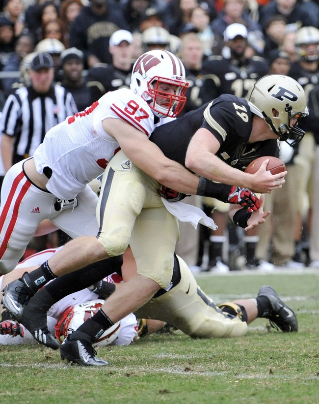 October 13, 2012;  West Lafayette, IN, USA; Wisconsin Badgers defensive lineman Brendan Kelly (97) sacks Purdue Boilermakers quarterback Caleb TerBush (19) at Ross Ade Stadium. Mandatory Credit: Sandra Dukes-US PRESSWIRE