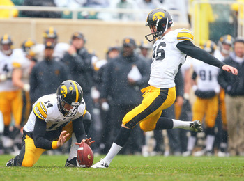 October 13, 2012; East Lansing, MI, USA; Iowa Hawkeyes kicker Mike Meyer (96) kicks field goal out of hold by Iowa Hawkeyes quarterback John Wienke (14)during 2nd half of  a game at Spartan Stadium. Iowa won 19-16 in overtime.   Mandatory Credit: Mike Car