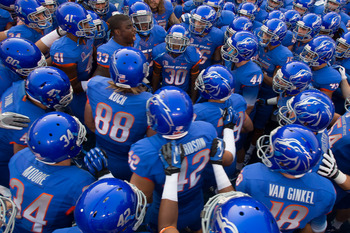 BOISE, ID - SEPTEMBER 20:  Tommy Smith #33 of the Boise State Broncos (without helmet) psyches up his team before the game against the BYU Cougars at Bronco Stadium on September 20, 2012 in Boise, Idaho.  (Photo by Otto Kitsinger III/Getty Images)