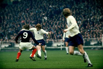 Alan Ball, on the ball for England.