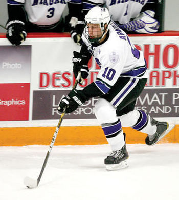 Arnold dekes with the puck for Niagara University during his NCAA career with the Purple Eagles-- Photo courtesy of www.buffalo.ynn.com