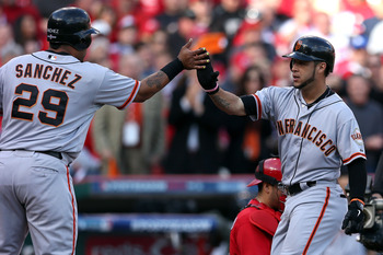 Gregor Blanco is congratulated by Hector Sanchez after his two-run home run