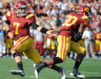 D.J. Morgan takes a handoff from QB Matt Barkley in a USC game against Utah