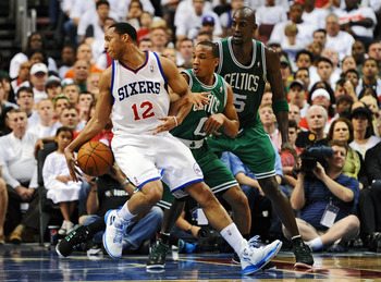 PHILADELPHIA, PA - MAY 18: Evan Turner #12 of the Philadelphia 76ers tries to spin around Avery Bradley #0 and Kevin Garnett #5 of the Boston Celtics in Game Four of the Eastern Conference Semifinals in the 2012 NBA Playoffs at the Wells Fargo Center on M
