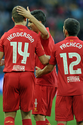 BERN, SWITZERLAND - SEPTEMBER 20:  Nuri Sahin (C) of Liverpool FC celebrates with Jordan Henderson (L) and Daniel Pacheco of Liverpool FC after scoring against BSC Young Boys during the UEFA Europa League Group A match between BSC Young Boys and Liverpool