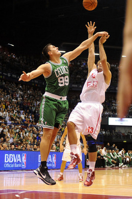 MILAN, ITALY - OCTOBER 07: Darko Milicic # 99 of Celtics competes with David Chiotti #13 of Armani  during the NBA Europe Live game between EA7 Emporio Armani Milano v Boston Celtics at Mediolanum Forum  on October 7, 2012 in Milan, Italy.  (Photo by Robe