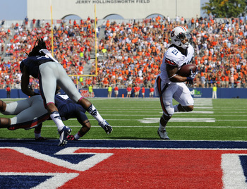 Auburn's Tre Mason scores in the second quarter. Photo credit: Todd Van Emst/Auburn Athletics