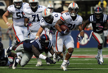 Tre Mason runs against Mississippi. Photo credit: Todd Van Emst/Auburn Athletics