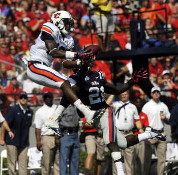 Auburn's Sammie Coates catches a 42-yard pass behind Ole Miss defender Senquez Golson in the second quarter. Photo credit: Todd Van Emst/Auburn Athletics