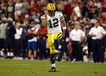 HOUSTON, TX - OCTOBER 14:  Aaron Rodgers #12 of the Green Bay Packers celebrates after a touchdown pass in the fourth quarter against the Houston Texans at Reliant Stadium on October 14, 2012 in Houston, Texas.  (Photo by Scott Halleran/Getty Images)