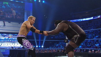Christian and Mark Henry meet in the squared circle.  Photo credit: Break.com