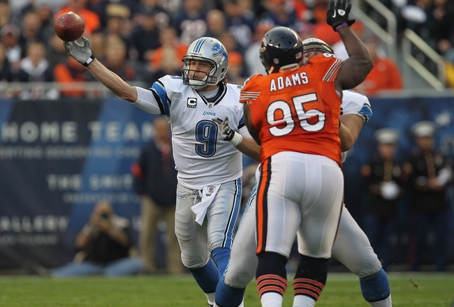 CHICAGO, IL - NOVEMBER 13:  Matthew Stafford #9 of the Detroit Lions throws a pass as Anthony Adams #95 of the Chicago Bears rushes at Soldier Field on November 13, 2011 in Chicago, Illinois. The Bears defeated the Lions 37-13.  (Photo by Jonathan Daniel/