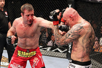 LAS VEGAS - JULY 03: (L-R) Stephan Bonnar throws a left to the face of Krzysztof Soszynski during the UFC light heavyweight bout at the MGM Grand Garden Arena on July 3, 2010 in Las Vegas, Nevada. (Photo by Josh Hedges/Zuffa LLC/Zuffa LLC via Getty Images)