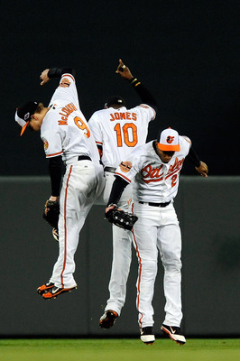 The Baltimore outfielders celebrate.