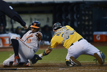 Adam Jones slides in to home.