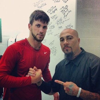 Washington Nationals rookie outfielder Bryce Harper (left) poses with Hugo Tandron (right), who served as the team's playoff barber. Photo Credit: Washington Times.