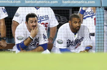 Gonzalez and Kemp reflecting in the dugout Oct. 2 against the Giants.