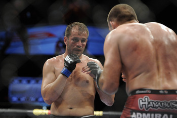 May 15, 2012; Fairfax, VA, USA; Fabio Maldonado (left) looks for an opening on Igor Pokrajac (right) during the Korean zombie vs Poirier event at Patriot Center.  Mandatory Credit: Rafael Suanes-US PRESSWIRE