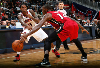 Lou Williams, seen dishing the ball into the post, is getting used to his new team— the Atlanta Hawks.
