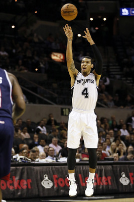 Oct 10, 2012; San Antonio, TX, USA; San Antonio Spurs guard Danny Green (4) shoots during the first half against the Atlanta Hawks at the AT&T Center. Mandatory Credit: Soobum Im-US PRESSWIRE