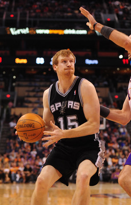Mar. 27, 2012; Phoenix, AZ, USA; San Antonio Spurs forward/center Matt Bonner controls the ball during game against the Phoenix Suns at the US Airways Center. The Spurs defeated the Suns 107-100. Mandatory Credit: Mark J. Rebilas-US PRESSWIRE
