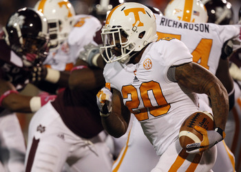 STARKVILLE, MS - OCTOBER 13:  Running back Rajion Neal #20 of the Tennessee Volunteers carries the ball against the Mississippi State Bulldogs on October 13, 2012 at Davis Wade Stadium in Starkville, Mississippi. (Photo by Butch Dill/Getty Images)