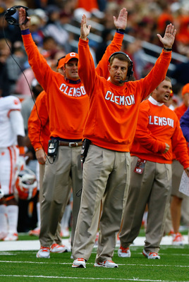 CHESTNUT HILL, MA - SEPTEMBER 29:  Head coach Dabo Swinney of the Clemson Tigers signals for a touchdown following an official review against the Boston College Eagles during the game on September 29, 2012 at Alumni Stadium in Chestnut Hill, Massachusetts