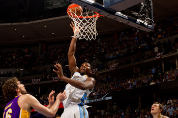 Kenneth Faried shoots the ball as Pau Gasol looks on