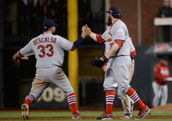 Daniel Descalso (33) and Jason Motte (right) continued the team's tradition of wearing high socks every sunday during a win over the San Francisco Giants in Game 1 of the NLCS.