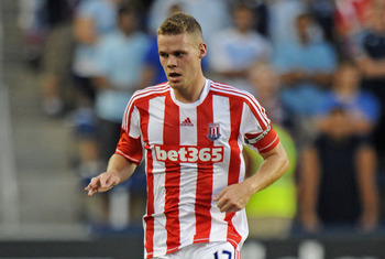 KANSAS CITY, KS - AUGUST 01:  Defender Ryan Shawcross #17 of Stoke City passes the ball up the field against Sporting Kansas City during the first half on August 1, 2012 at LiveStrong Sporting Park in Kansas City, Kansas.  (Photo by Peter Aiken/Getty Imag