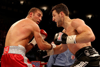 Lucian Bute (left) looks on in horror as Carl Froch goes in for the kill.