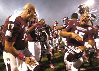 Tyler Russell and back up quarterback Dak Prescott celebrate the Bulldogs victory over Tennessee
