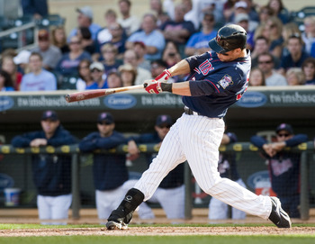 MINNEAPOLIS, MN - SEPTEMBER 9:  Justin Morneau #33 of the Minnesota Twins hits a walk off home run against the Cleveland Indians in the ninth inning at Target Field on September 9, 2012 in Minneapolis, Minnesota.  The Twins defeated the Indians 8-7.  (Pho