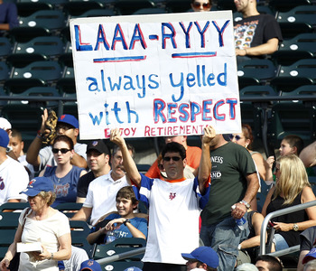 NEW YORK - SEPTEMBER 08:  A fan holds a sign in honor of Chipper Jones #10 of the Atlanta Braves during a game against the New York Mets at Citi Field on September 8, 2012 in the Flushing neighborhood of the Queens borough of New York City.  Jones is reti