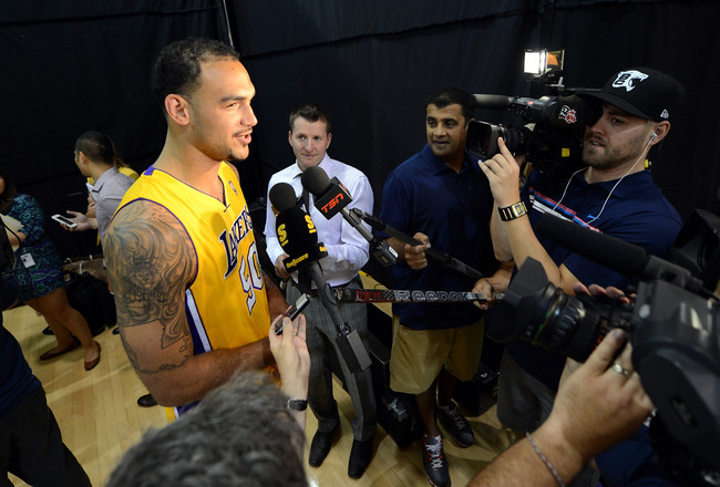 EL SEGUNDO, CA - OCTOBER 01:  Robert Sacre #50 of the Los Angeles Lakers speaks to the media during Media Day at Toyota Sports Center on October 1, 2012 in El Segundo, California.  (Photo by Harry How/Getty Images)