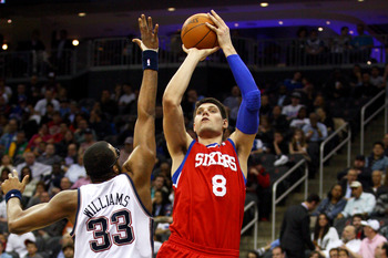 Nikola Vucevic shoots while playing for Philadelphia.
