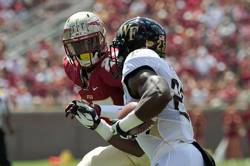 TALLAHASSEE, FL - SEPTEMBER 15:  Joshua Harris #25 of the Wake Forest Demon Deacons is pursued by Xavier Rhodes #27 of the Florida State Seminoles during a game at Doak Campbell Stadium on September 15, 2012 in Tallahassee, Florida.  (Photo by Stacy Rever