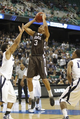 Mar 18, 2012; Greensboro, NC, USA; Lehigh Mountain Hawks guard C.J. McCollum (3) shoots as Xavier Musketeers guards Dee Davis (0) and Mark Lyons (10) defend during the second half. The Bluejays defeated the Mountain Hawks 70-58 in the third round of the 2