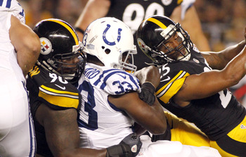 PITTSBURGH, PA - AUGUST 19:  Steve McLendon #90 and Ryan Clark #25 of the Pittsburgh Steelers tackle Vick Ballard #33 of the Indianapolis Colts during the game on August 19, 2012 at Heinz Field in Pittsburgh, Pennsylvania.  (Photo by Justin K. Aller/Getty