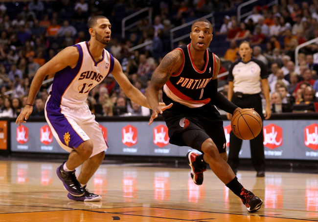 PHOENIX, AZ - OCTOBER 12:  Damian Lillard #0 of the Portland Trail Blazers drives the ball past P.J. Tucker #17 of the Phoenix Suns during the preseason NBA game at US Airways Center on October 12, 2012 in Phoenix, Arizona.  NOTE TO USER: User expressly a