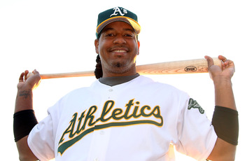 Manny posed in his A's uniform despite never taking a regular season at-bat for the team.