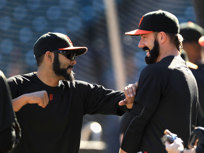 SAN FRANCISCO - OCTOBER 13:  Brian Wilson and Sergio Romo of the San Francisco Giants joke around during a workout session in preparation for the National League Championship Series at AT&T Park on October 13, 2010 in San Francisco, California.  (Photo by