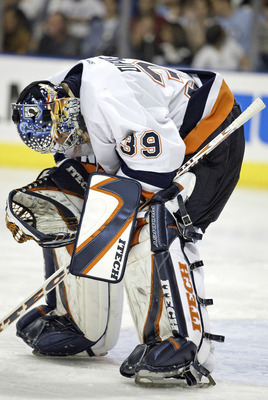 TAMPA, FL - APRIL 16:  New York Islanders goalie Rick DiPietro #39 hangs his head after losing to the Tampa Bay Lightning in the first round of the Stanley Cup Playoffs on April 16, 2004 at the St. Petersburg Times Forum in Tampa, Florida. The Lightning w