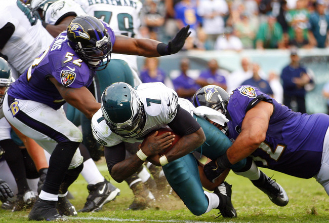PHILADELPHIA, PA - SEPTEMBER 16: Quarterback Michael Vick #7 of the Philadelphia Eagles scores a touchdown on a six yard in the fourth quarter as Ray Lewis #52 and Haloti Ngata #92 of the Baltimore Ravens tackle him in the end zone during a game at Lincol
