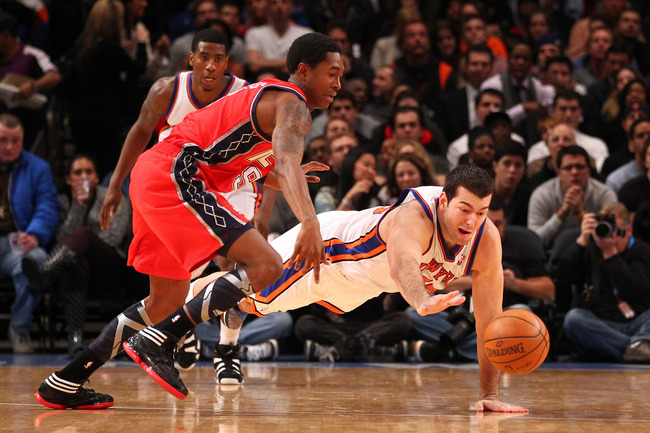 NEW YORK, NY - DECEMBER 21:  Josh Harrellson #55 of the New York Knicks steals the ball from Marshon Brooks #9 of the New Jersey Nets during their pre season game  at Madison Square Garden on December 21, 2011 in New York City. NOTE TO USER: User expressl
