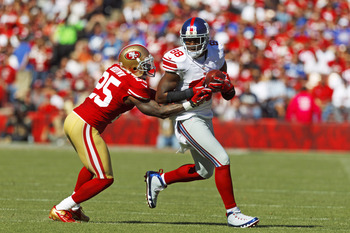 Hakeem Nicks trying to elude cornerback Tarell Brown.